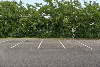 Carpark with empty spots, apartment moving